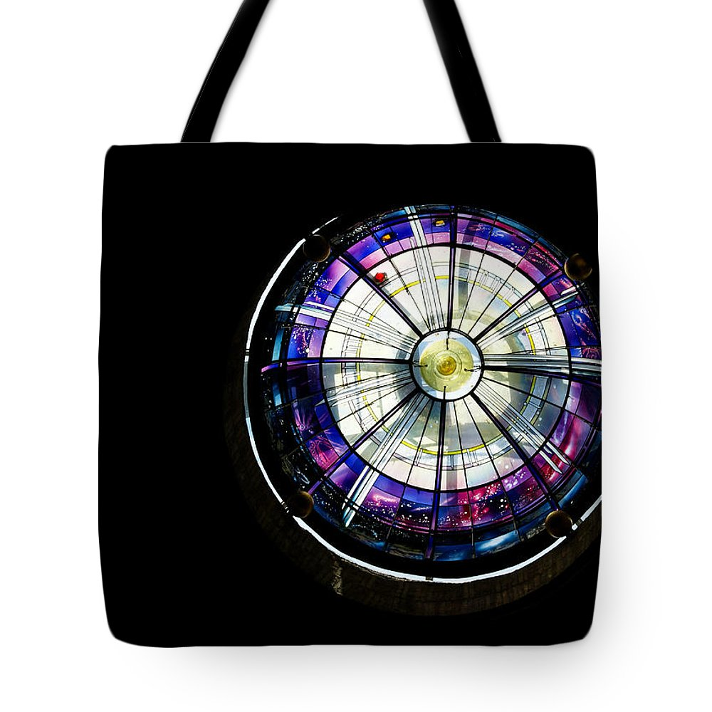 Abstract Tote Bag featuring the photograph A Dazzling Stained Glass Gem Emerging From The Darkness by Georgia Mizuleva