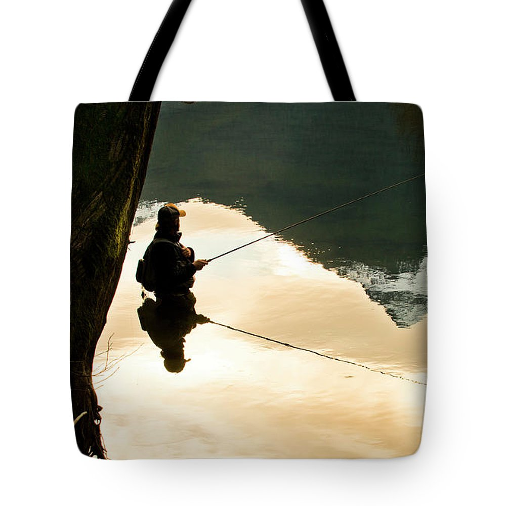 Adult Tote Bag featuring the photograph A Fly Fisherman Standing In A River by Rob Hammer