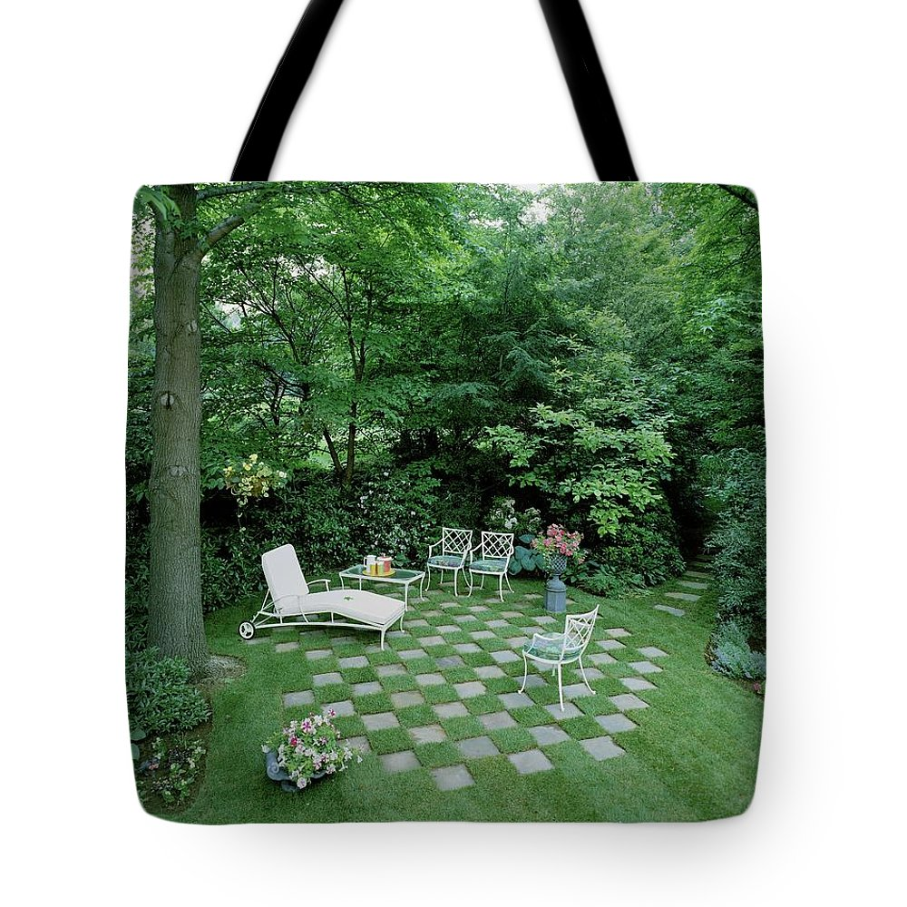 Decorative Art Tote Bag featuring the photograph A Garden With Checkered Pavement by Pedro E. Guerrero