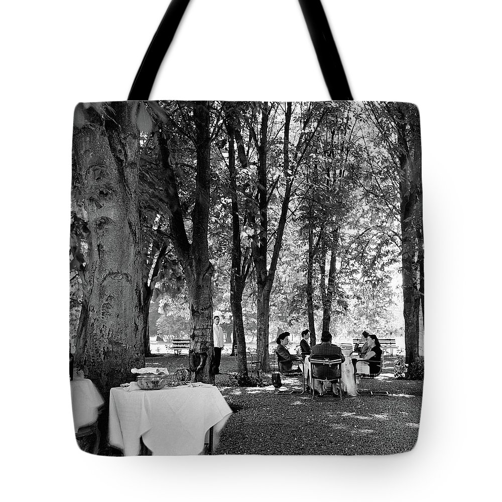 Food Tote Bag featuring the photograph A Group Of People Eating Lunch Under Trees by Luis Lemus