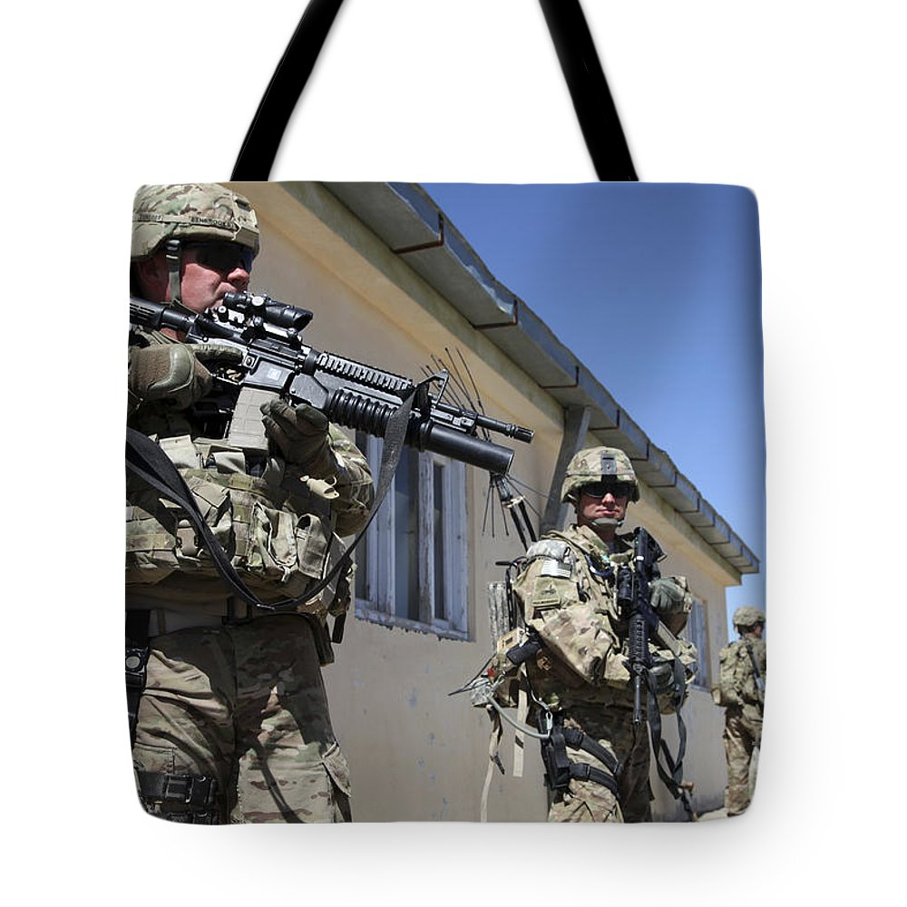 Afghanistan Tote Bag featuring the photograph A Group Of U.s. Army Soldiers Provide by Stocktrek Images