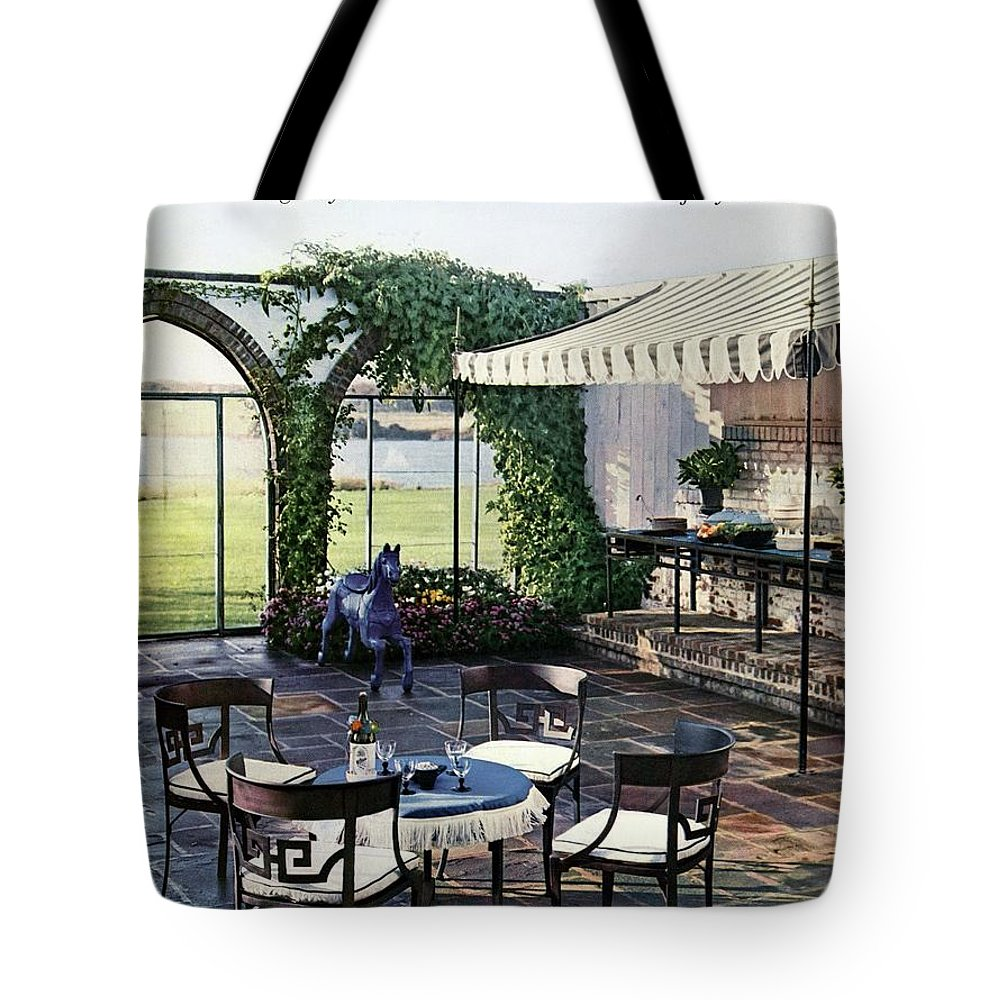 Magazine Tote Bag featuring the photograph A House And Garden Cover Of A Terrace In East by Wiliam Grigsby