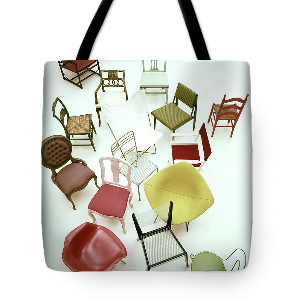 Renovation Tote Bag featuring the photograph A Large Group Of Chairs by Herbert Matter