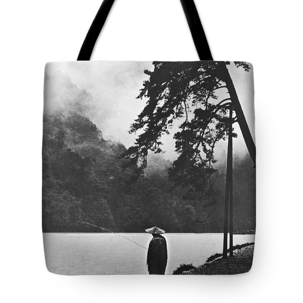 1 Person Tote Bag featuring the photograph A Lone Japanese Fisherman by Underwood Archives