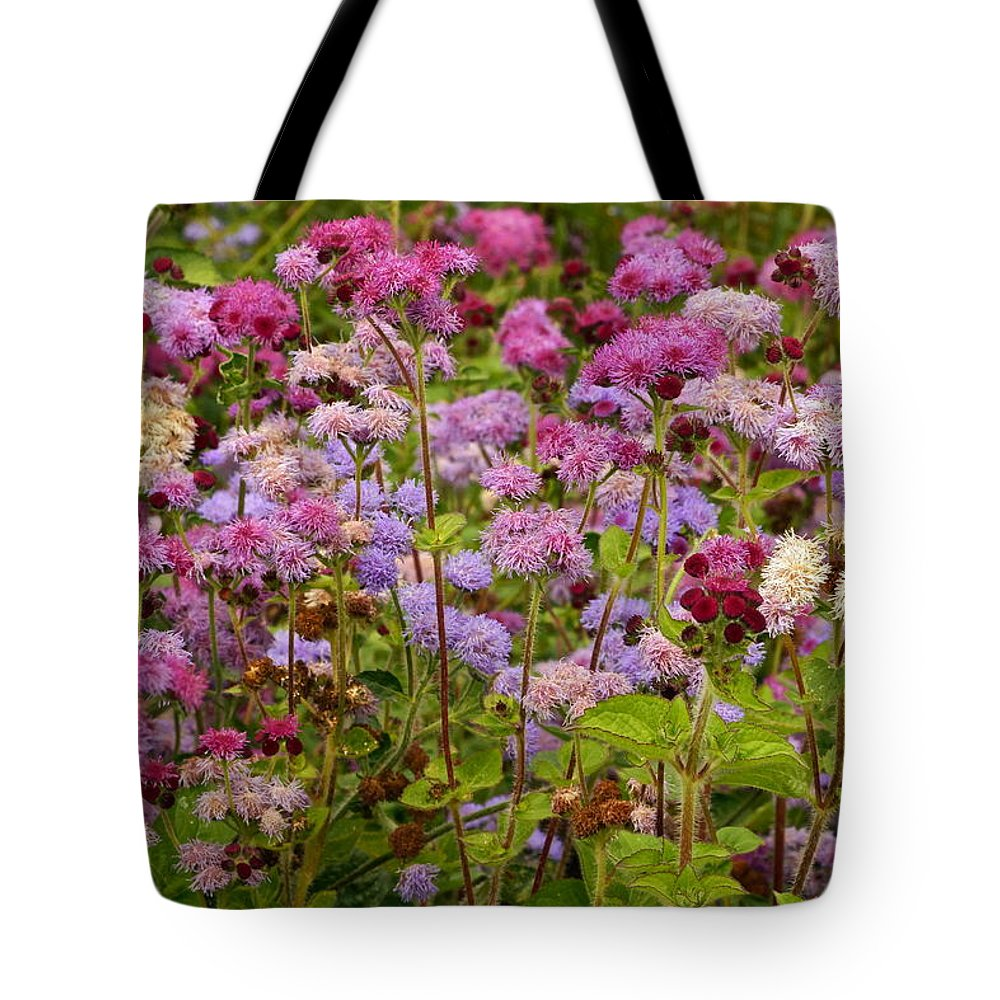 Colorful Small Flower Group Tote Bag featuring the photograph A Lovely Fall Palette by Byron Varvarigos
