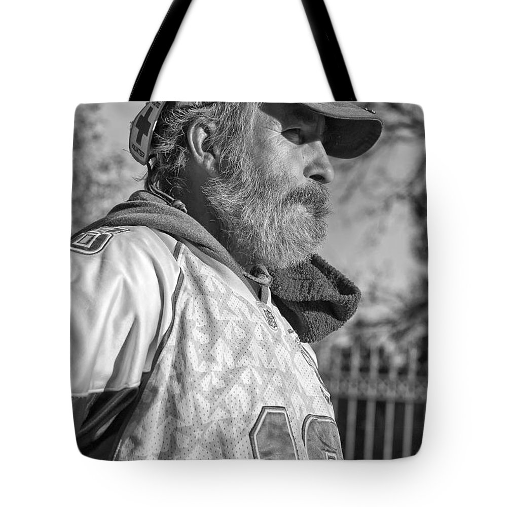 Man Tote Bag featuring the photograph A Man With A Purpose Monochrome by Steve Harrington