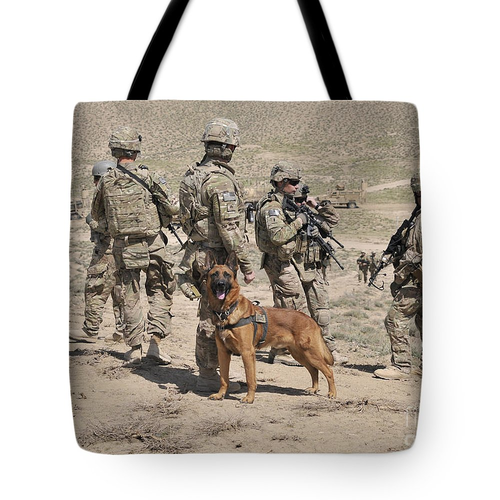 Afghanistan Tote Bag featuring the photograph A Military Working Dog Accompanies U.s by Stocktrek Images