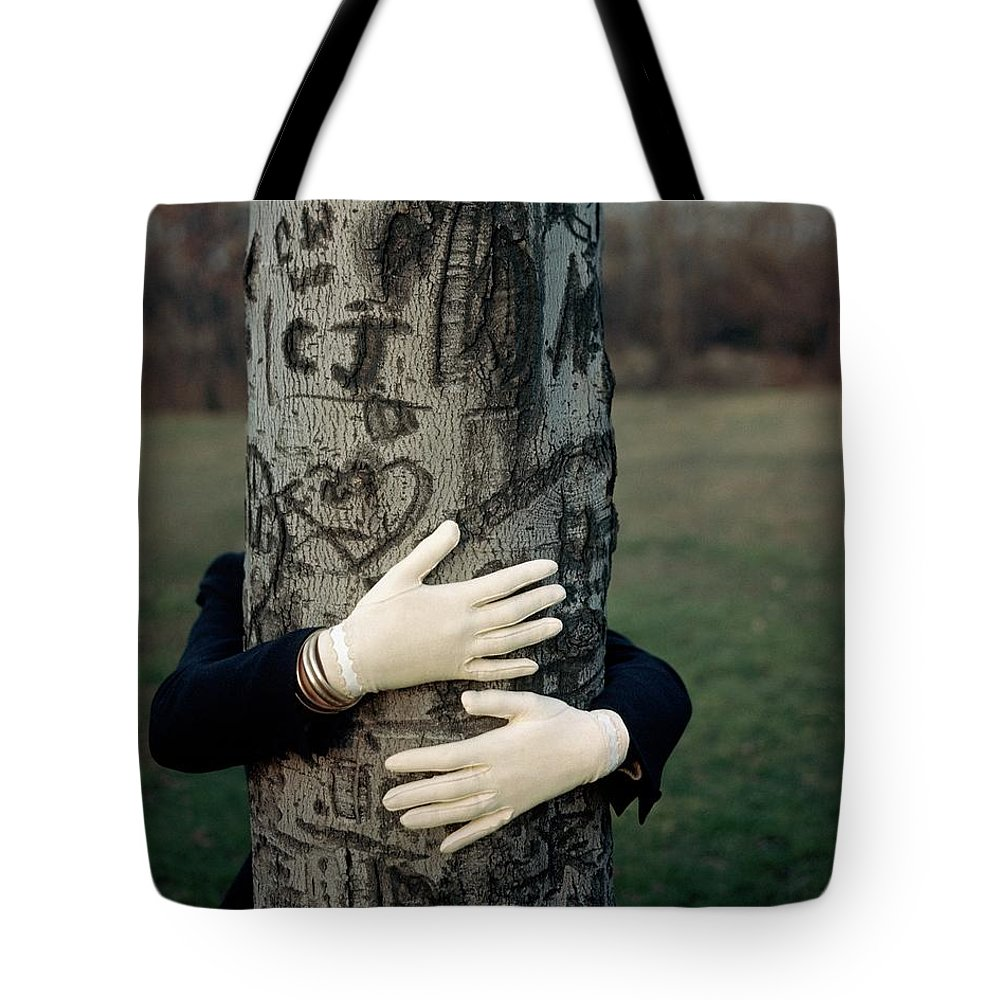 Fashion Tote Bag featuring the photograph A Model Hugging A Tree by Frances Mclaughlin-Gill