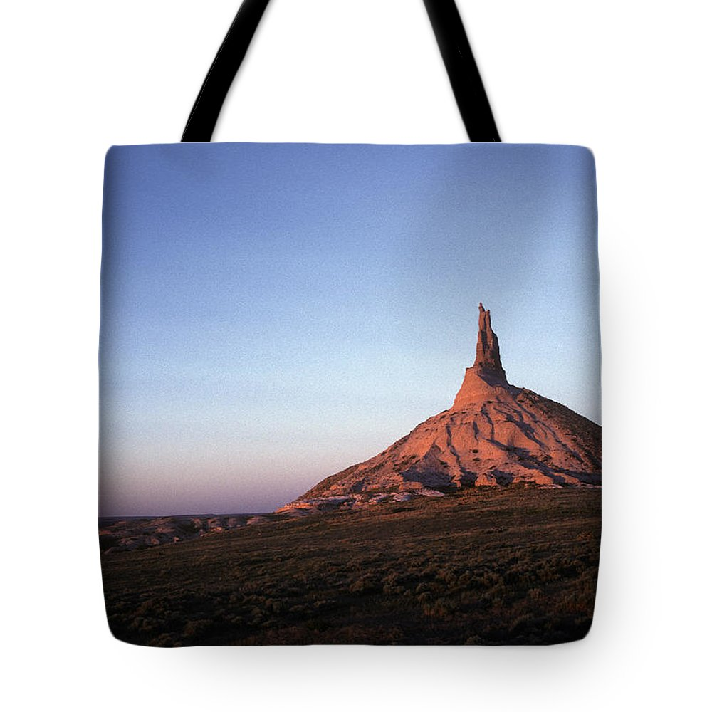 America Tote Bag featuring the photograph A Mountain Surrounded By Prairies by Scott Warren