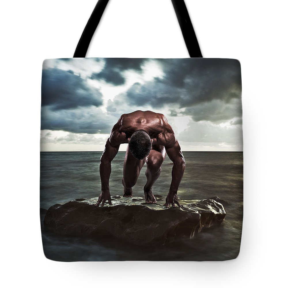 Ocean Tote Bag featuring the photograph A Muscular Man In The Starting Position by Ben Welsh