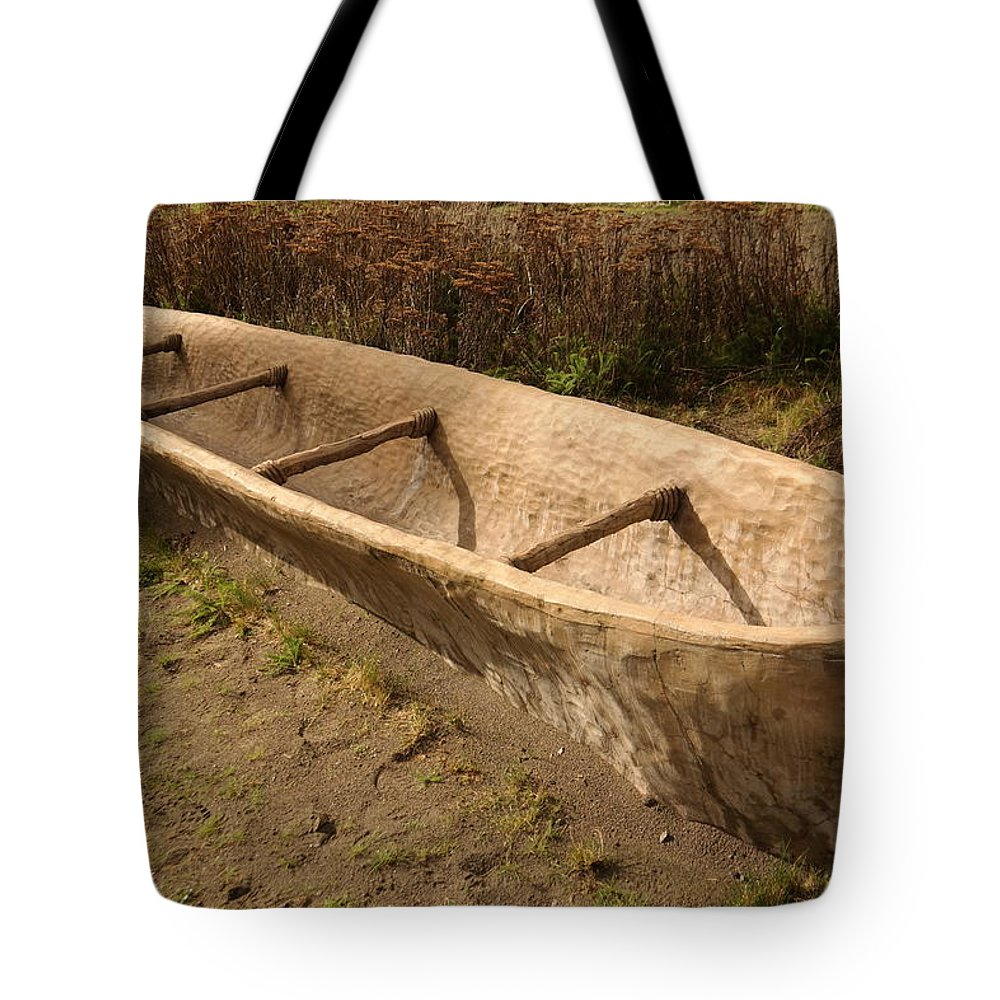 Native Tote Bag featuring the photograph A Native American Fishing Boat by Jeff Swan