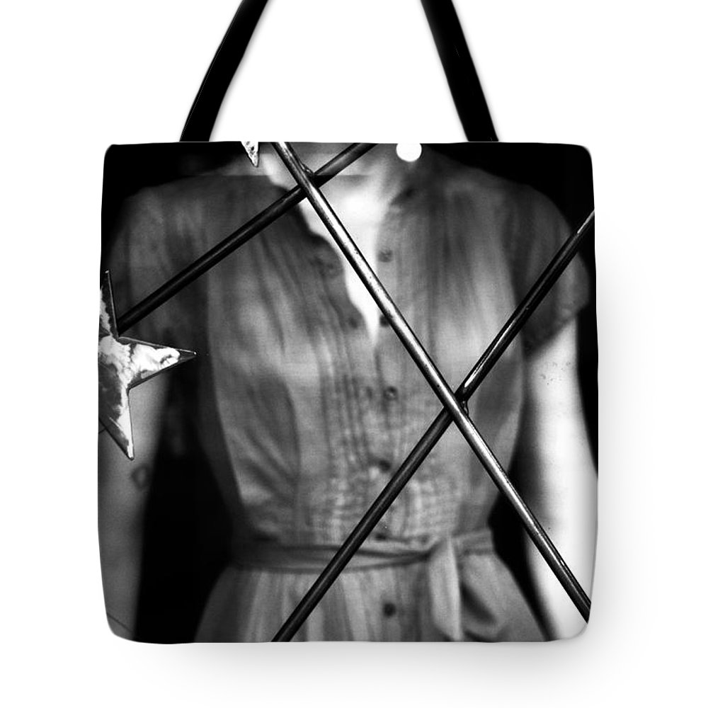 Black And White Tote Bag featuring the photograph A Ordinary Star by The Artist Project