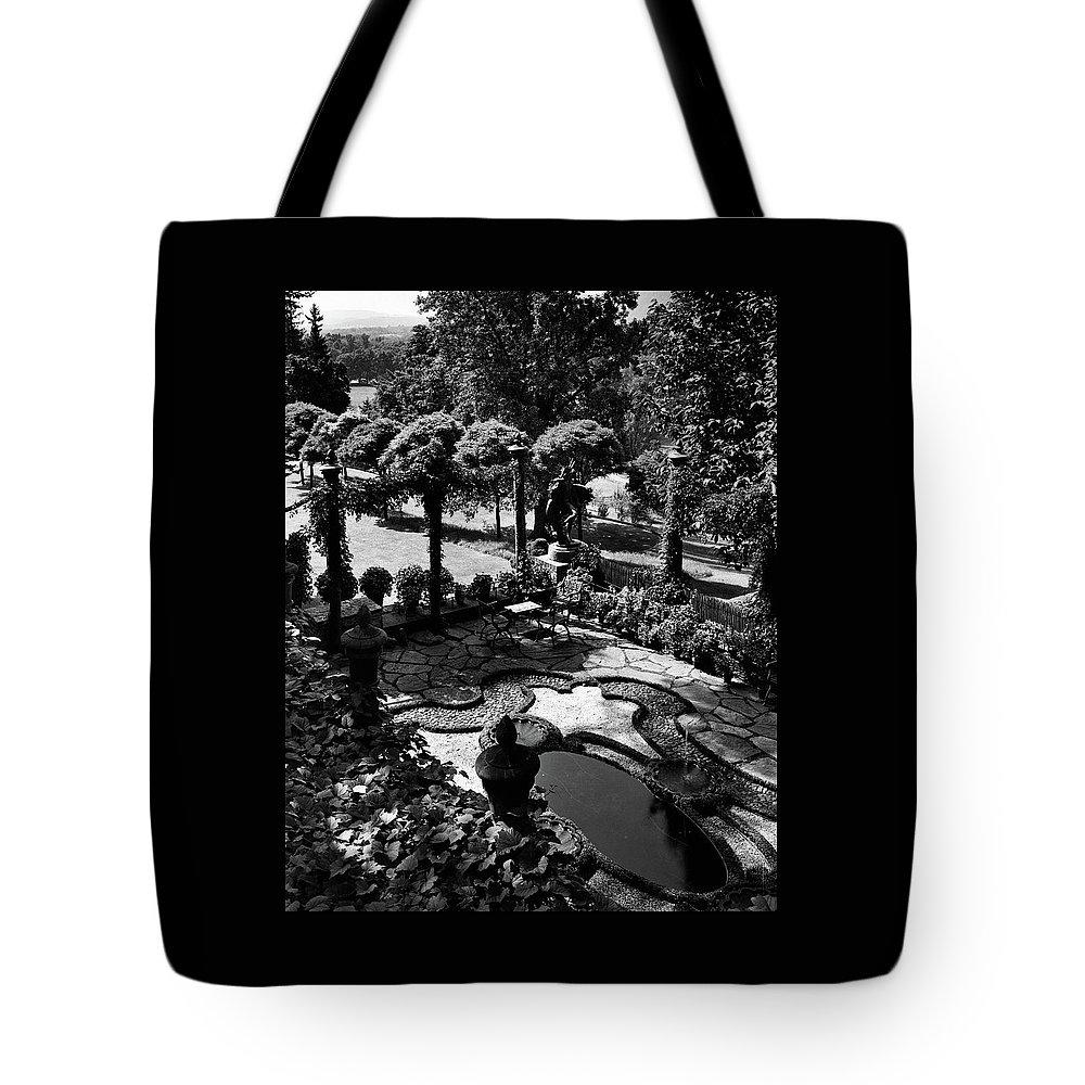 Garden Tote Bag featuring the photograph A Pond In An Ornamental Garden by Gottscho-Schleisner