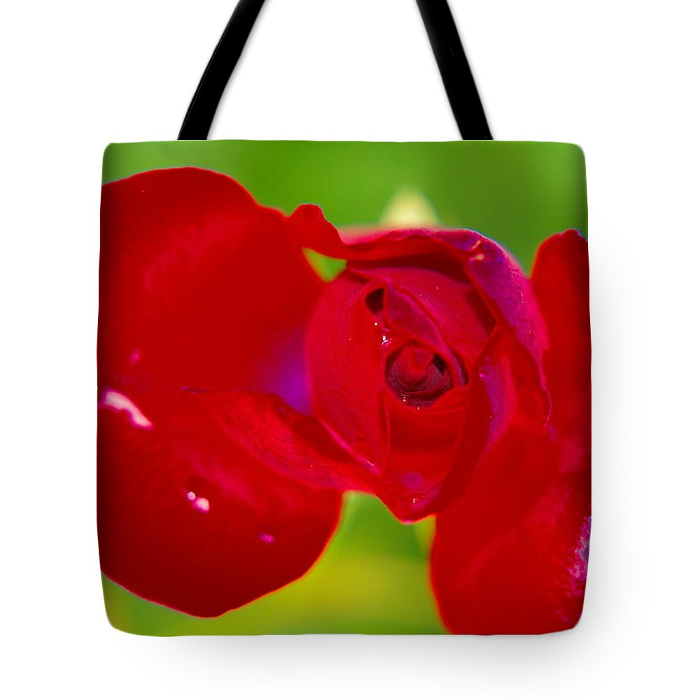 Flowers Tote Bag featuring the photograph A Red Wet Rose by Jeff Swan
