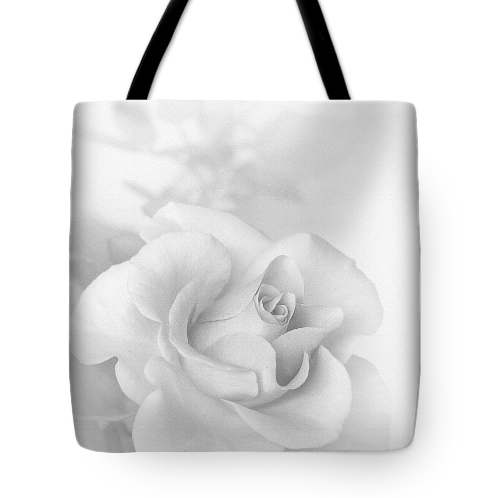 Black And White Tote Bag featuring the photograph A Rose With No Color by David and Carol Kelly