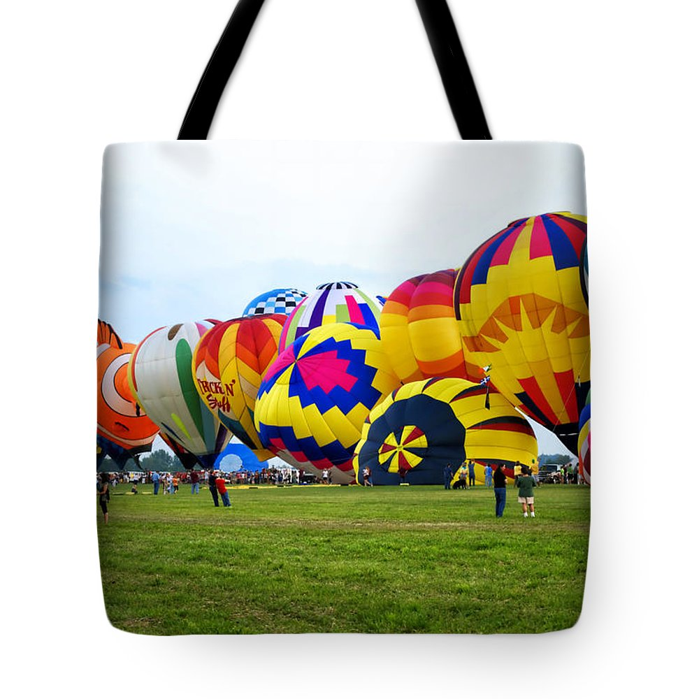 Hot Air Balloon Tote Bag featuring the photograph A Row Of Hot Air Balloons Left Side by Thomas Woolworth