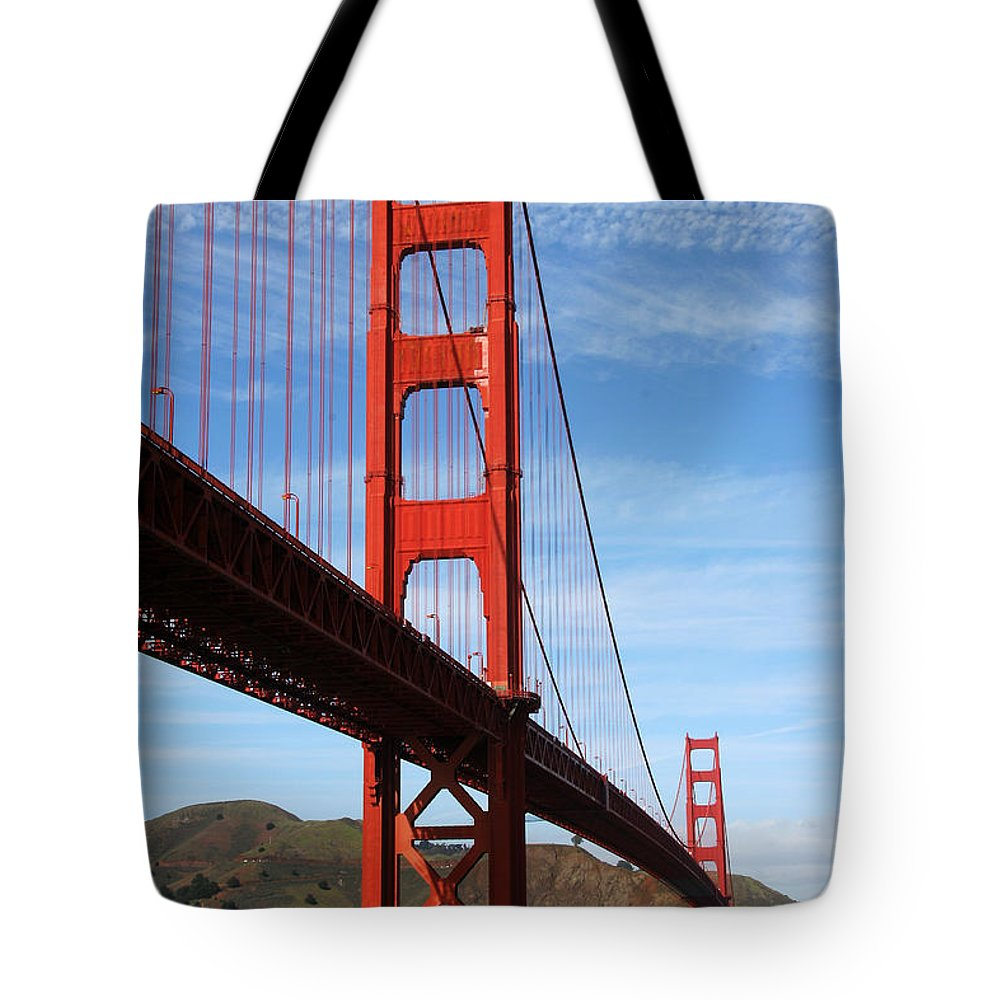Golden Gate Bridge Tote Bag featuring the photograph A San Francisco Icon by Robert Woodward