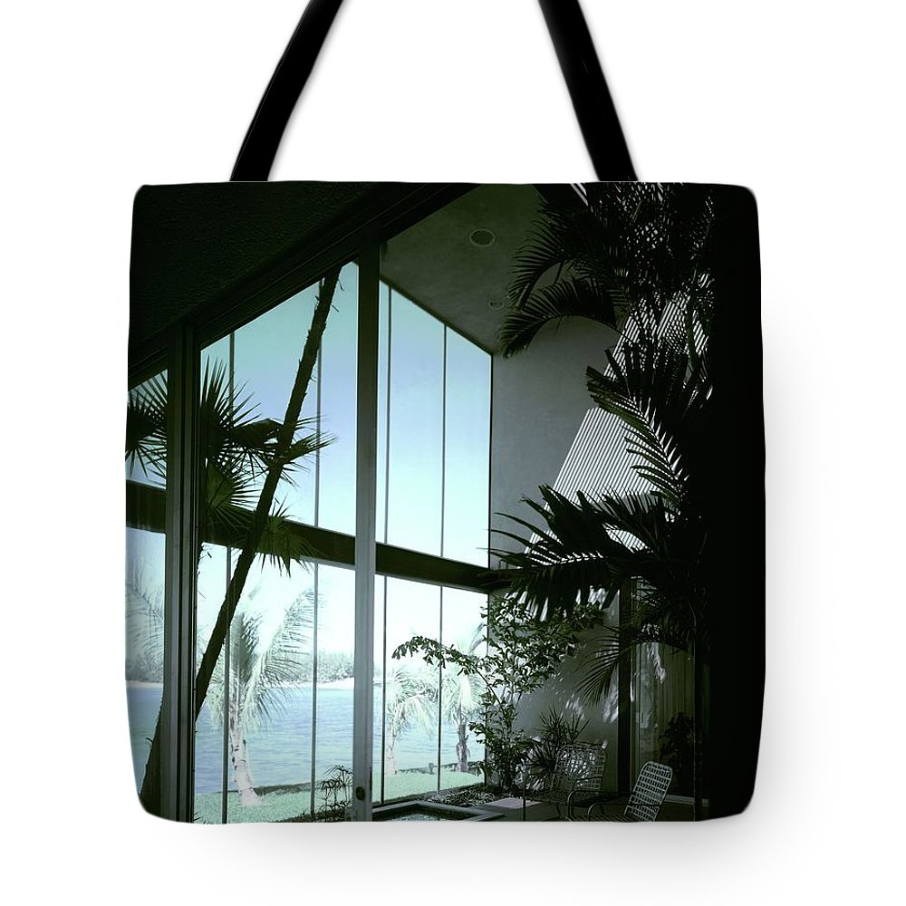 Architecture Tote Bag featuring the photograph A Screened Patio by Robert M. Damora