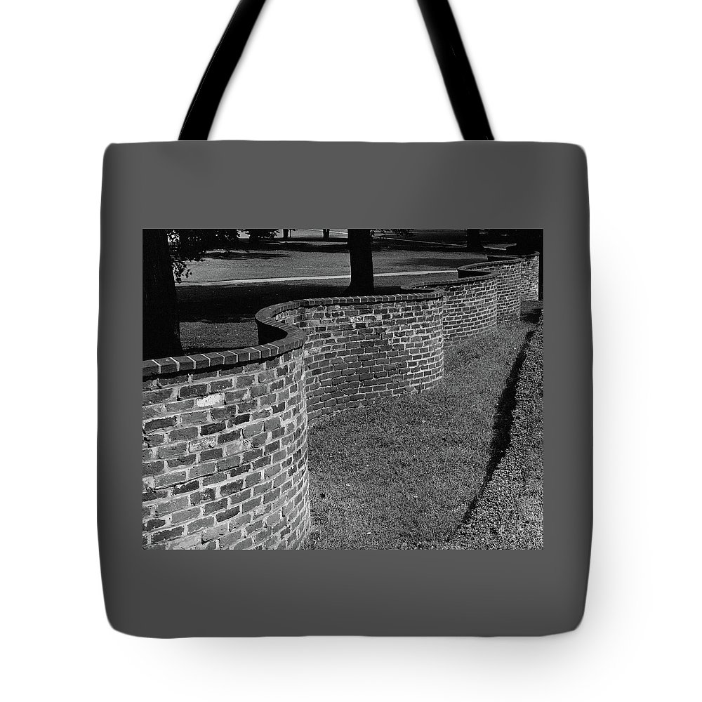 Exterior Tote Bag featuring the photograph A Serpentine Brick Wall by William and Neill Dingledine