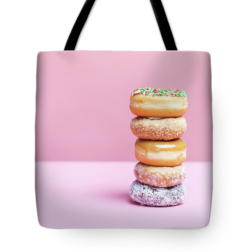 Five Objects Tote Bag featuring the photograph A Stack Of Various Donuts by Steven Errico