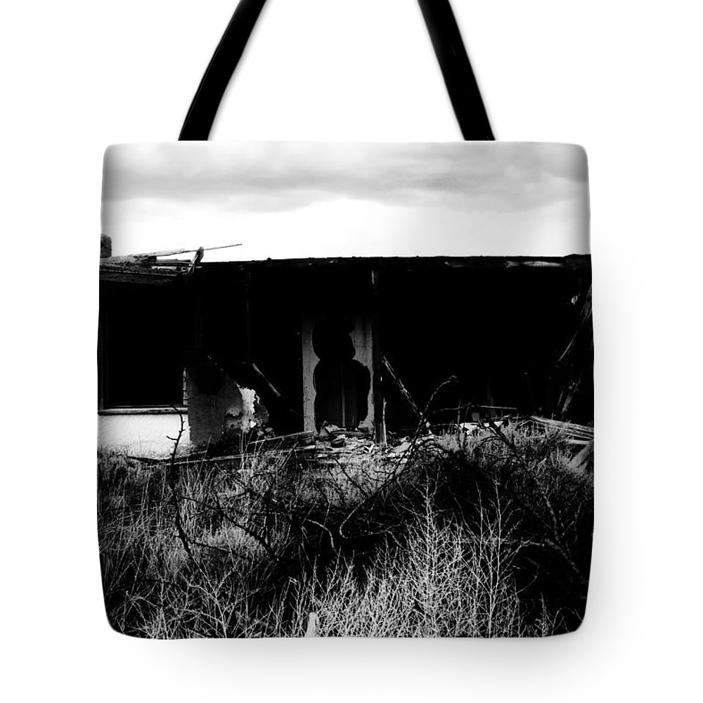 Black Tote Bag featuring the photograph A Story Ends by Jessica Shelton