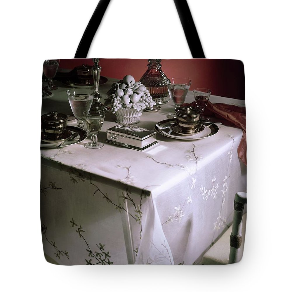 Indoors Tote Bag featuring the photograph A Table Set With Delicate Tableware by Horst P. Horst