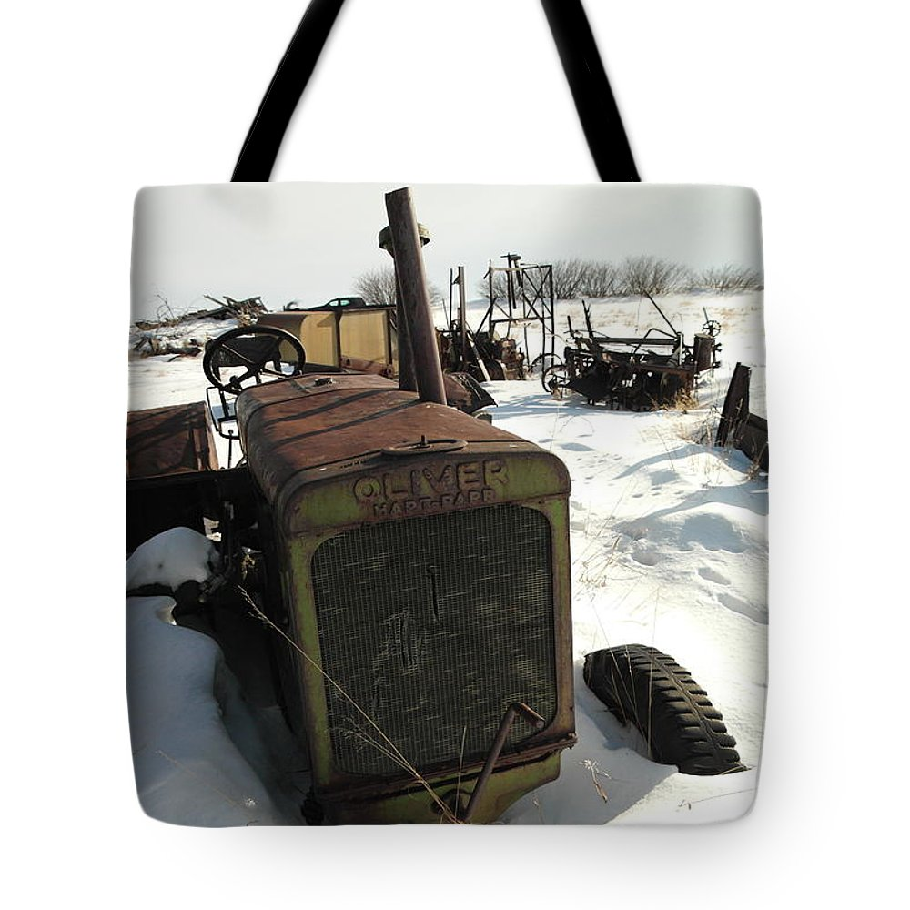 Tractors Tote Bag featuring the photograph A Tractor In The Snow by Jeff Swan