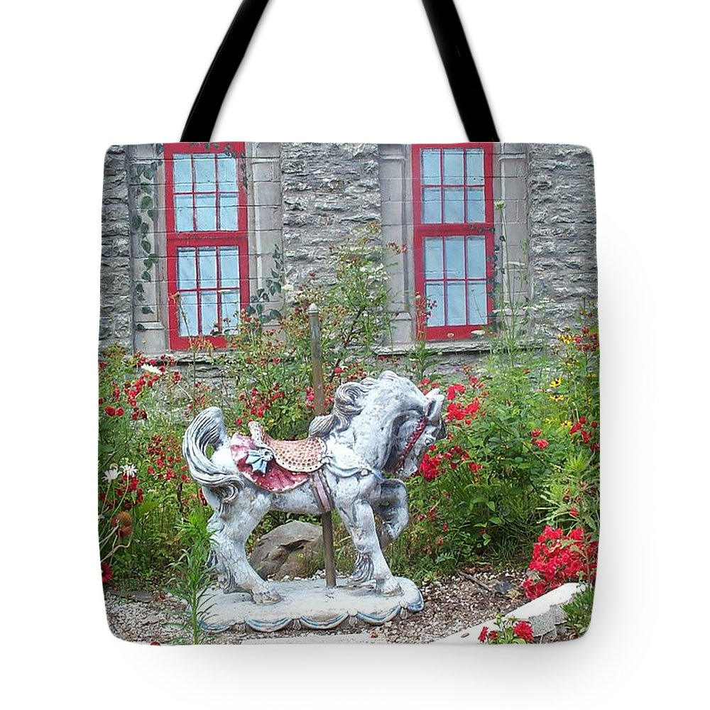 Carousel Pony Tote Bag featuring the photograph A Treasure In A Garden by Barbara McDevitt