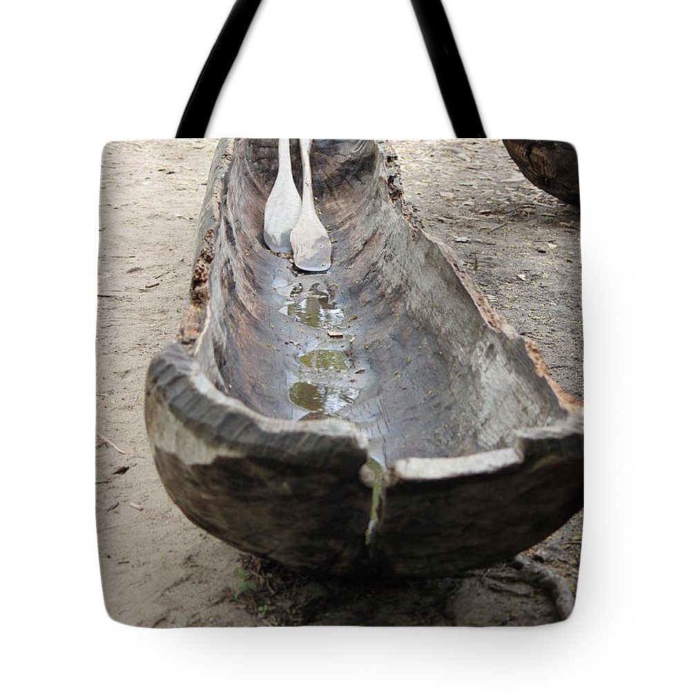 Dugout Tote Bag featuring the photograph A Typical Indigenous Dugout by Jennifer E Doll