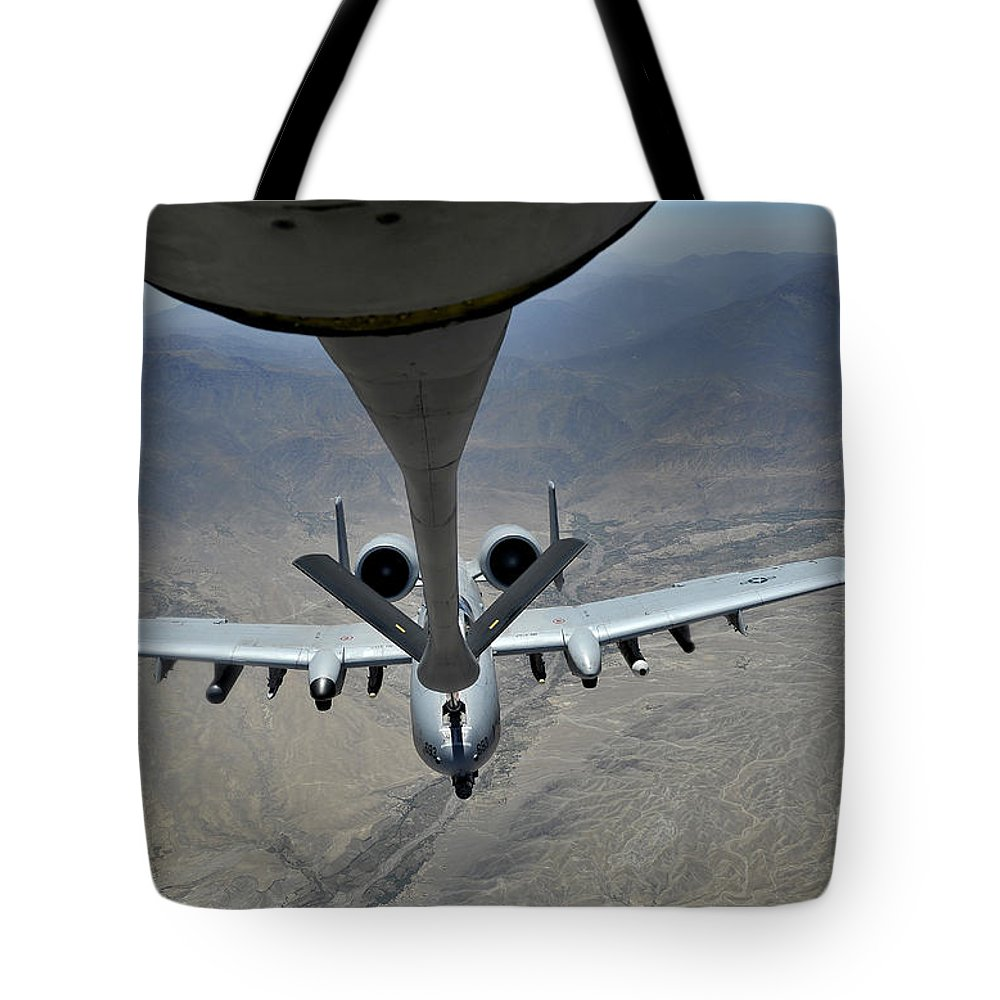 Middle East Tote Bag featuring the photograph A U.s. Air Force A-10 Thunderbolt by Stocktrek Images
