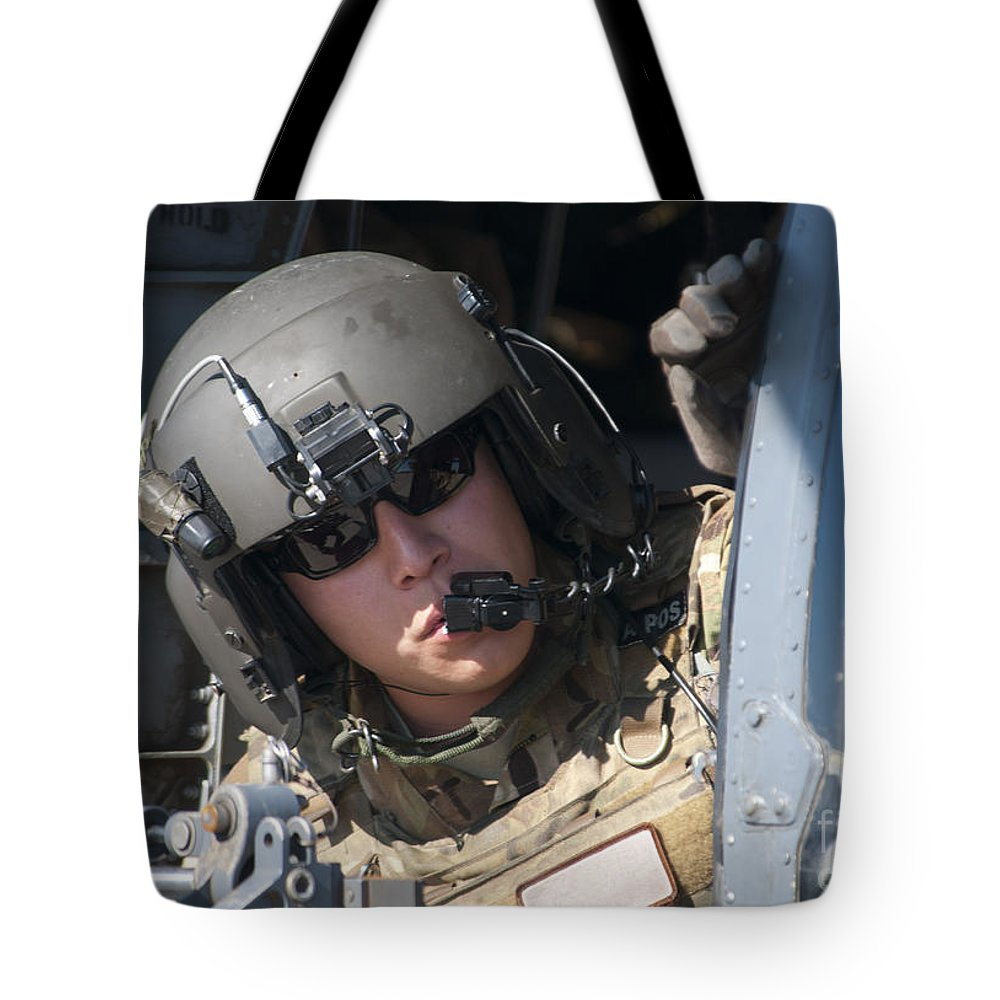 Horizontal Tote Bag featuring the photograph A U.s. Air Force Airman Peers by Stocktrek Images