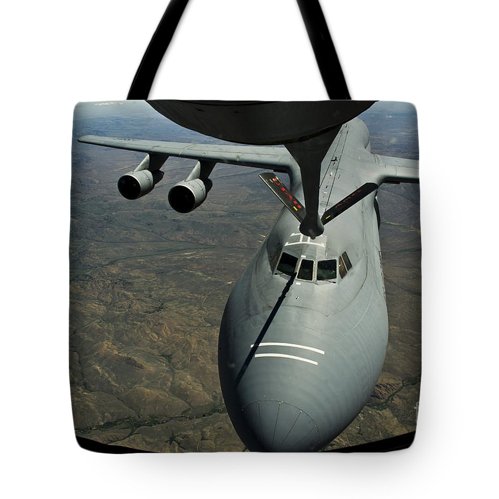 Us Air Force Tote Bag featuring the photograph A U.s. Air Force Kc-135r Stratotanker by Stocktrek Images