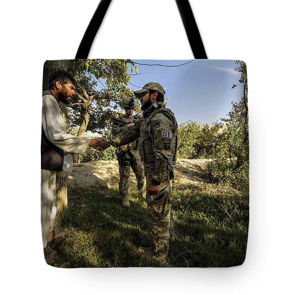 Air Force Tote Bag featuring the photograph A U.s. Air Force Master Sergeant by Stocktrek Images