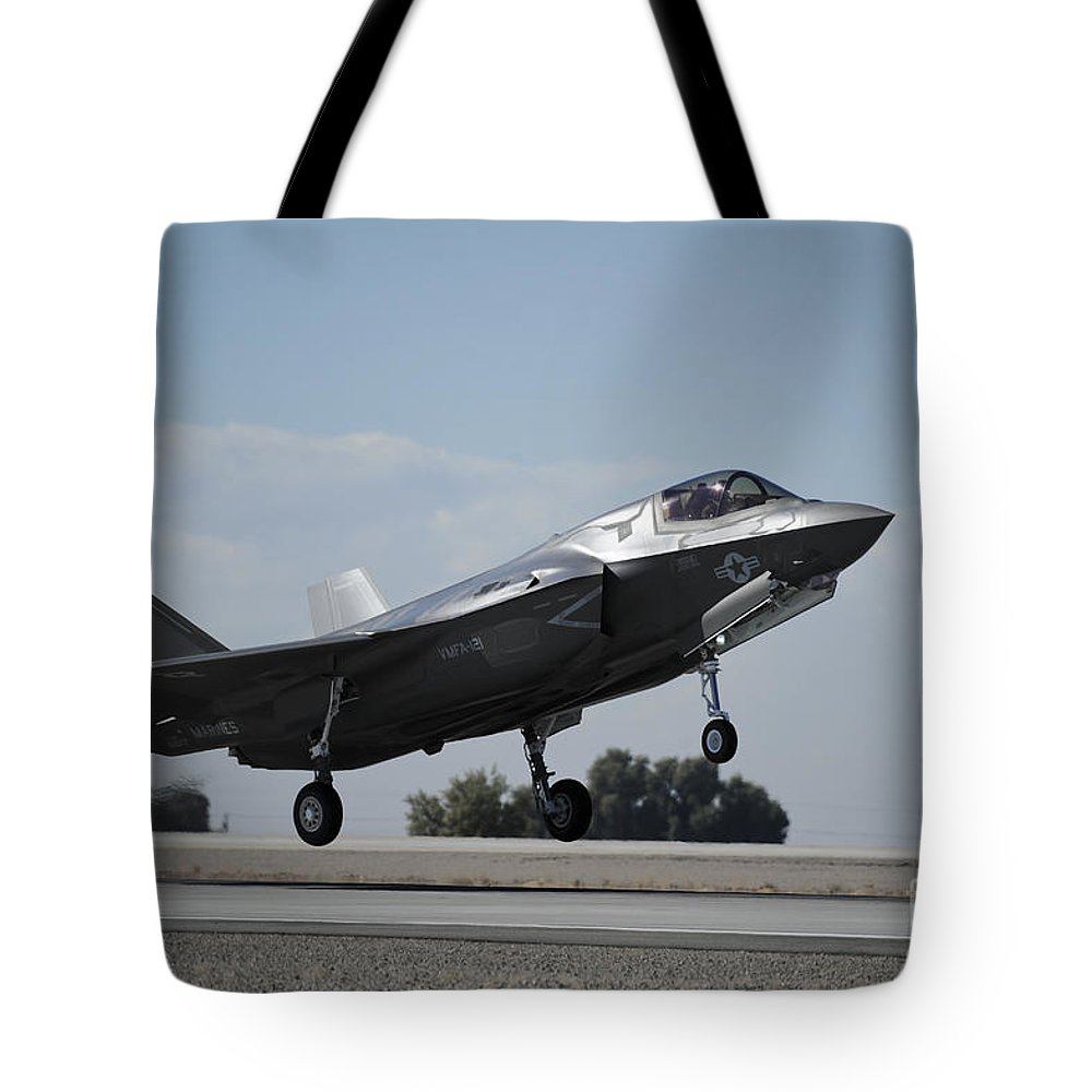 Marine Corps Air Station Tote Bag featuring the photograph A U.s. Marine Corps F-35b Aircraft by Stocktrek Images