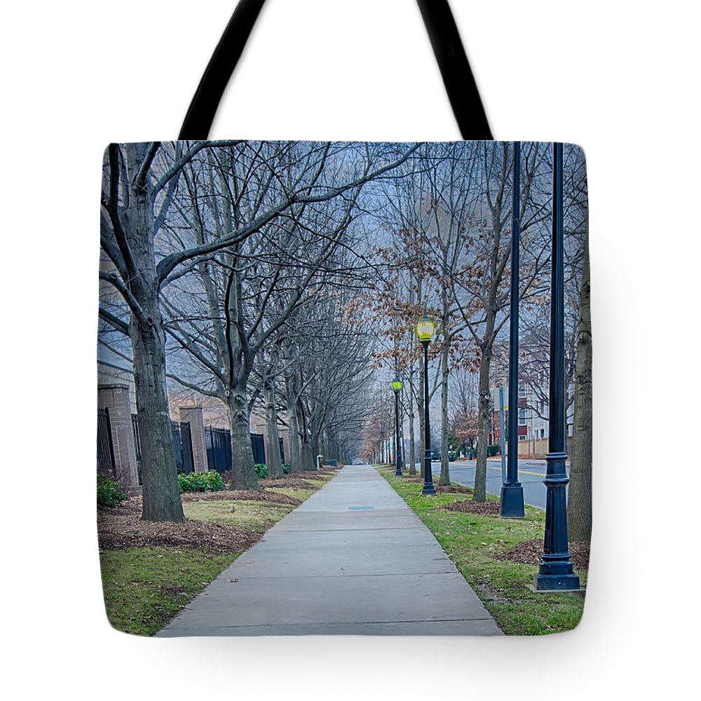 A Walk Tote Bag featuring the photograph A Walk On A Sidewalk Street Alley by Alex Grichenko