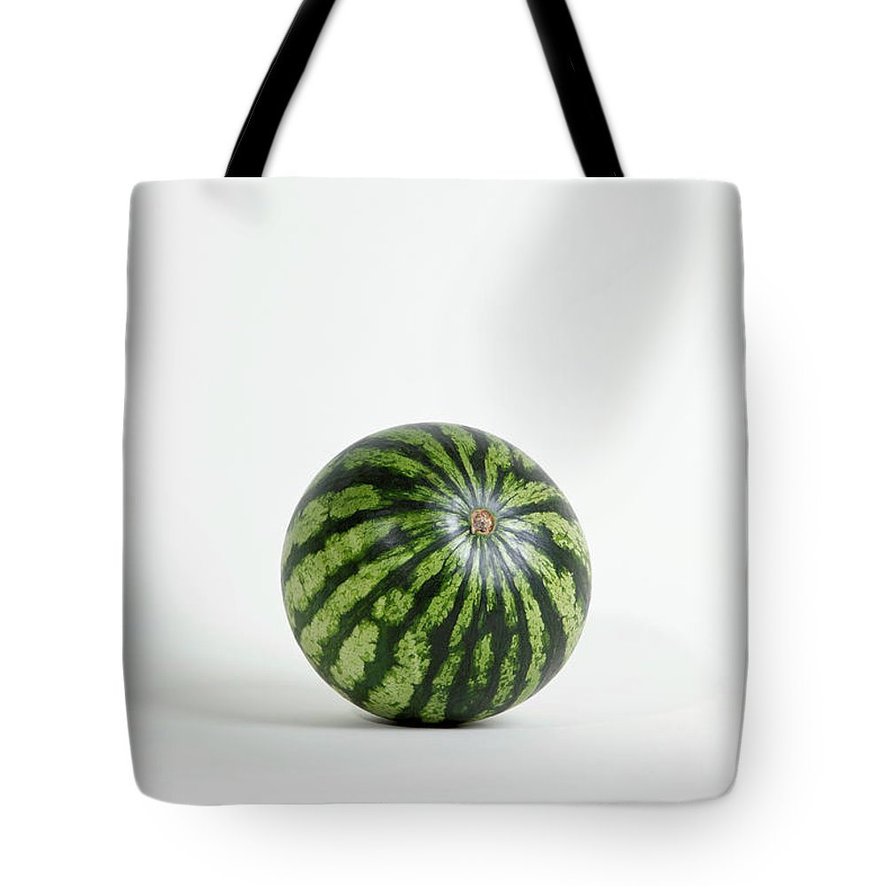 Shadow Tote Bag featuring the photograph A Whole Ripe Watermelon, Studio Shot by Halfdark