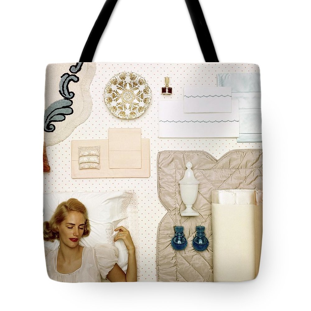 Bedroom Tote Bag featuring the photograph A Woman Sleeping Next To An Assorted Range by Geoffrey Baker