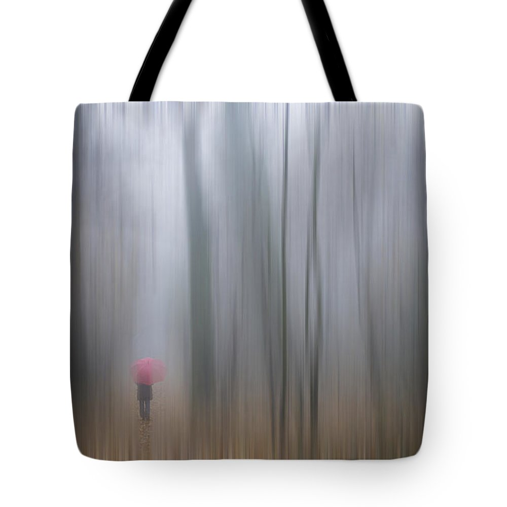 Sheer Tote Bag featuring the photograph A Woman Walking With A Red Umbrella by Mats Silvan