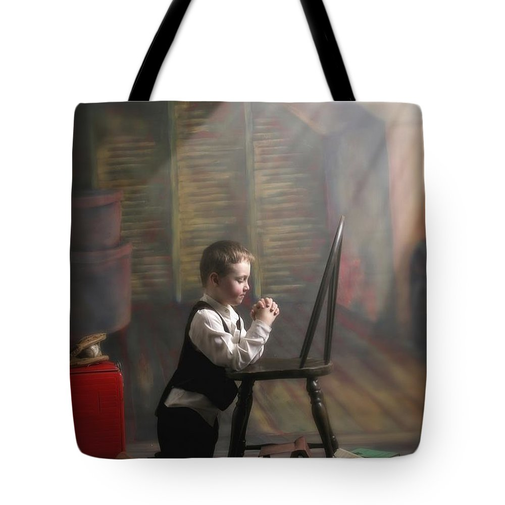 Inspirational Tote Bag featuring the photograph A Young Boy Praying With A Light Beam by Pete Stec