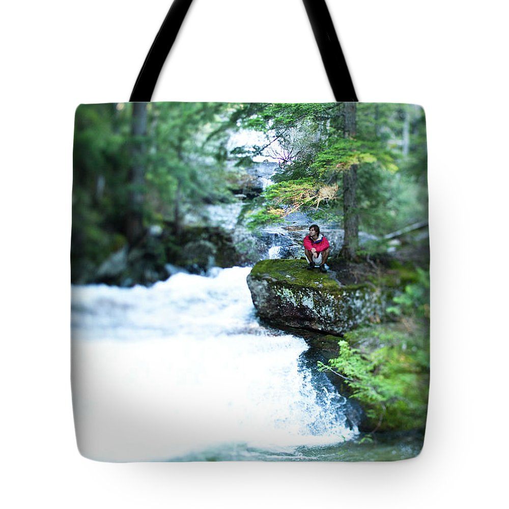 20-24 Years Tote Bag featuring the photograph A Young Man Sits Peacefully Taking by Patrick Orton