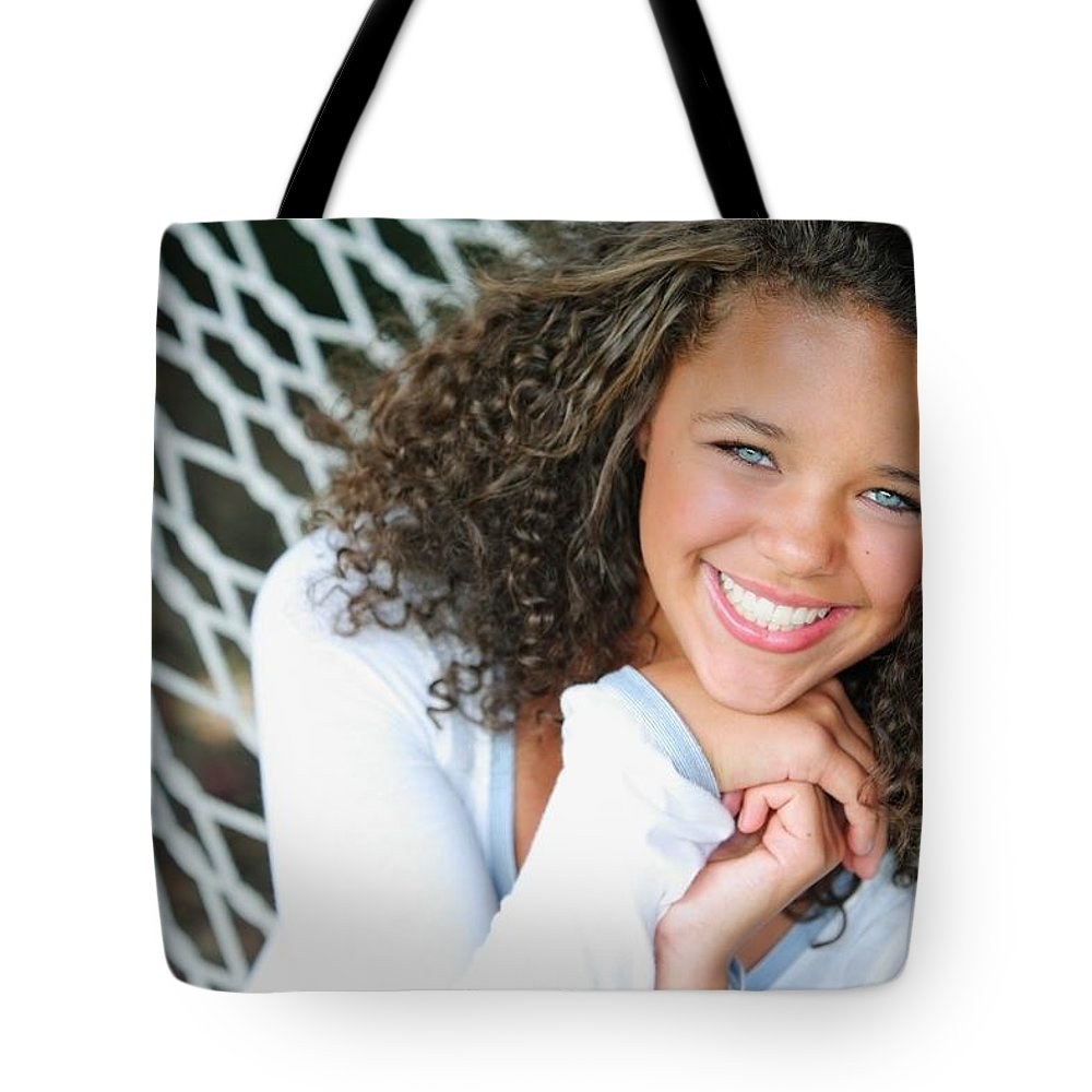 Blue Eyes Tote Bag featuring the photograph A Young Woman On A Hammock by Colleen Cahill