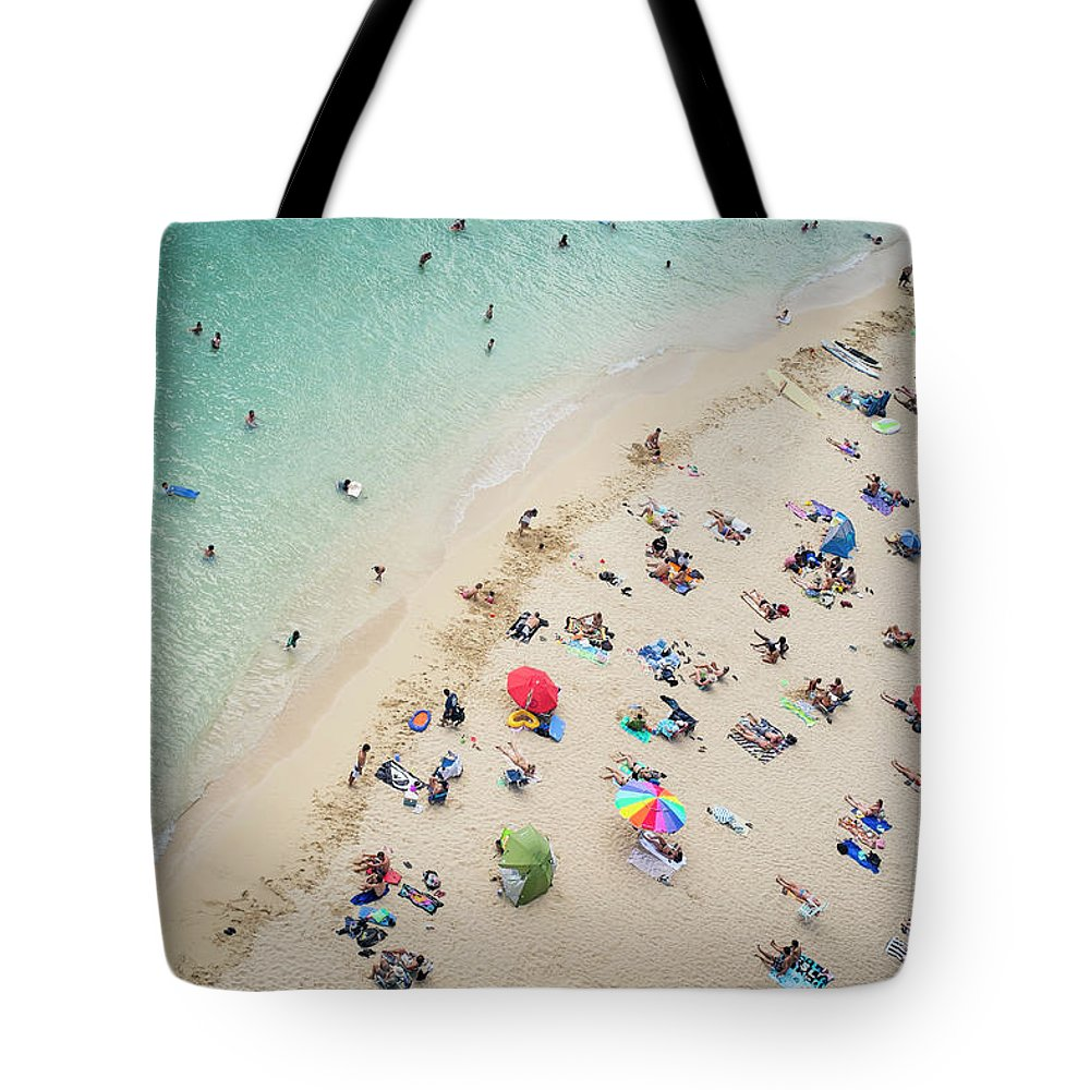 Honolulu Tote Bag featuring the photograph Aerial View Of Tourists On Beach by Alberto Guglielmi