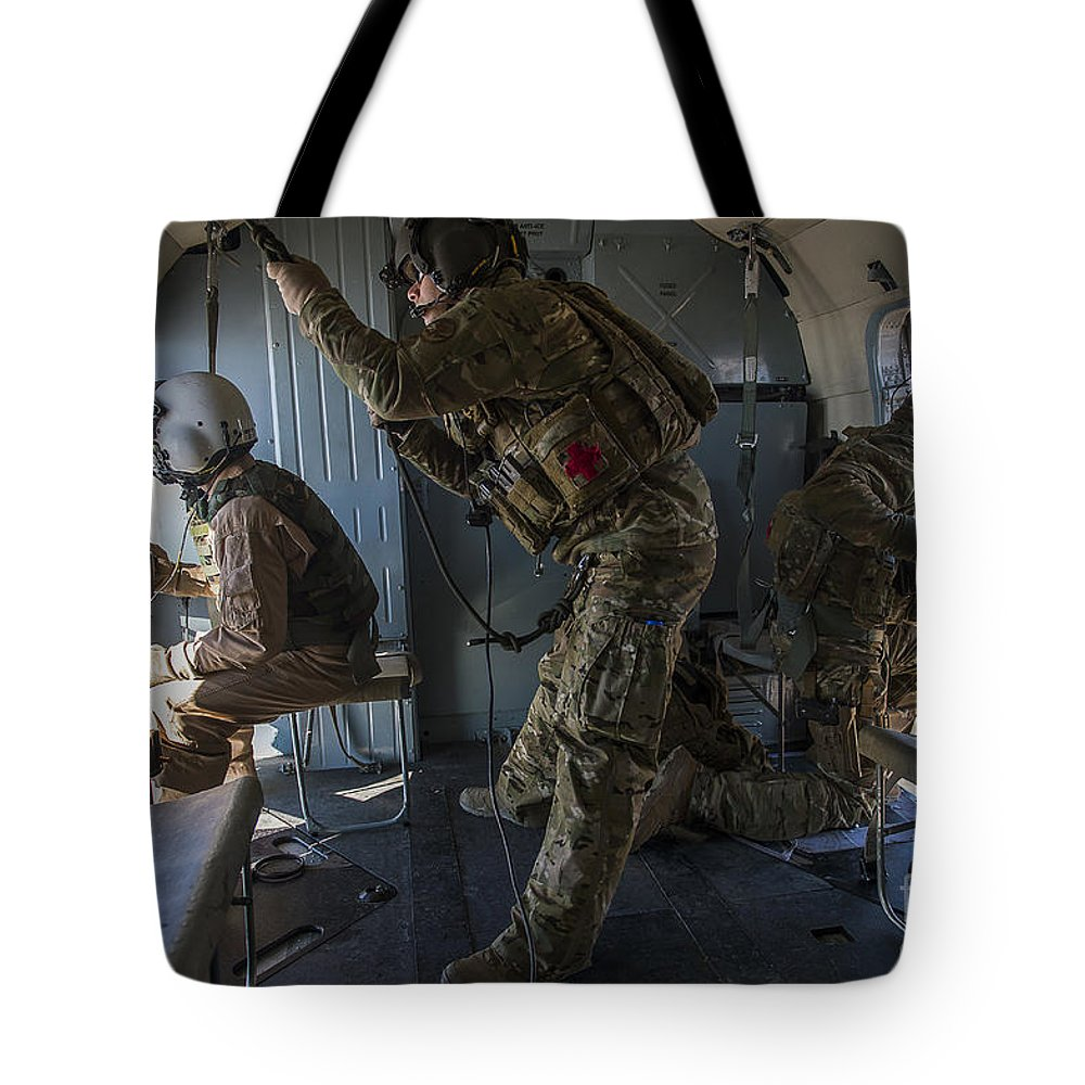 Afghanistan Tote Bag featuring the photograph Afghan Air Force Members by Stocktrek Images