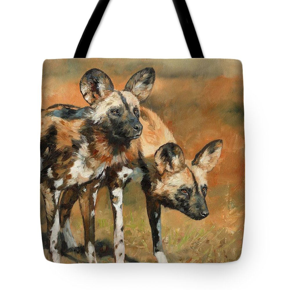 Wild Dogs Tote Bag featuring the painting African Wild Dogs by David Stribbling