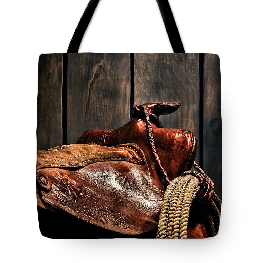 Saddle Tote Bag featuring the photograph After The Round Up by Olivier Le Queinec