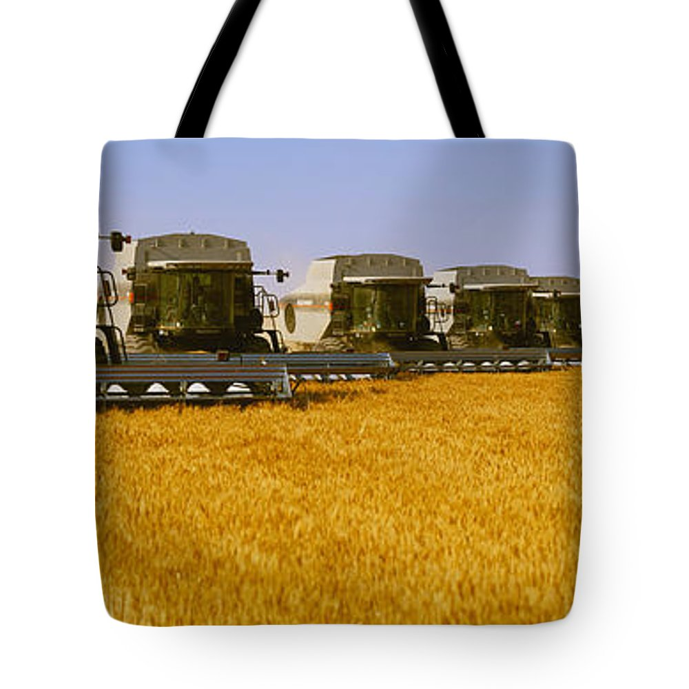 Country Tote Bag featuring the photograph Agriculture - Six Gleaner Combines by Timothy Hearsum