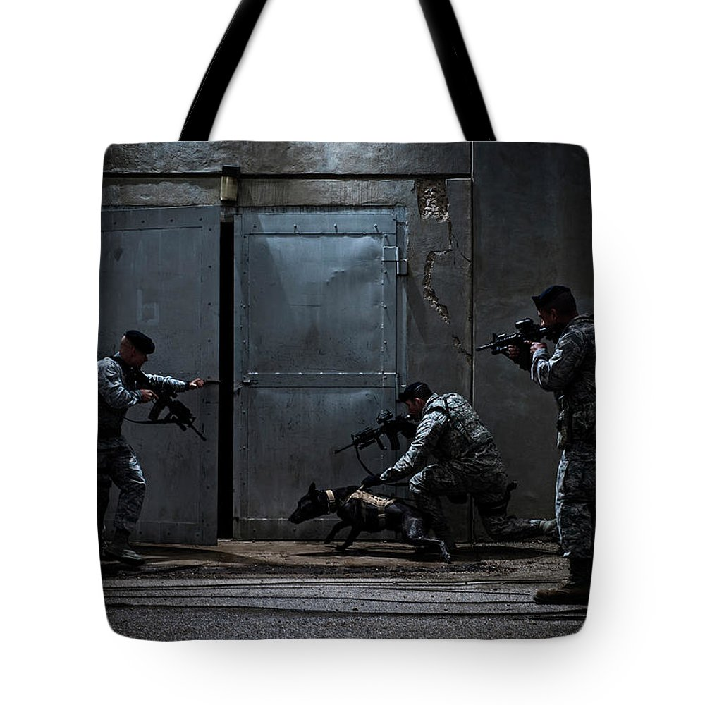 Building Exterior Tote Bag featuring the photograph Air Force Security Forces Members by Stacy Pearsall