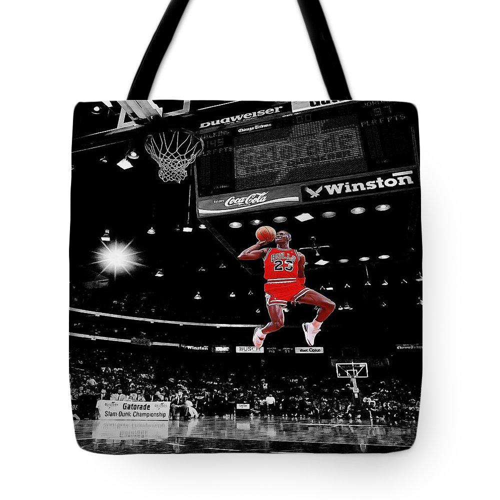 871ad8bdb300 Michael Jordan Tote Bag featuring the photograph Air Jordan by Brian Reaves