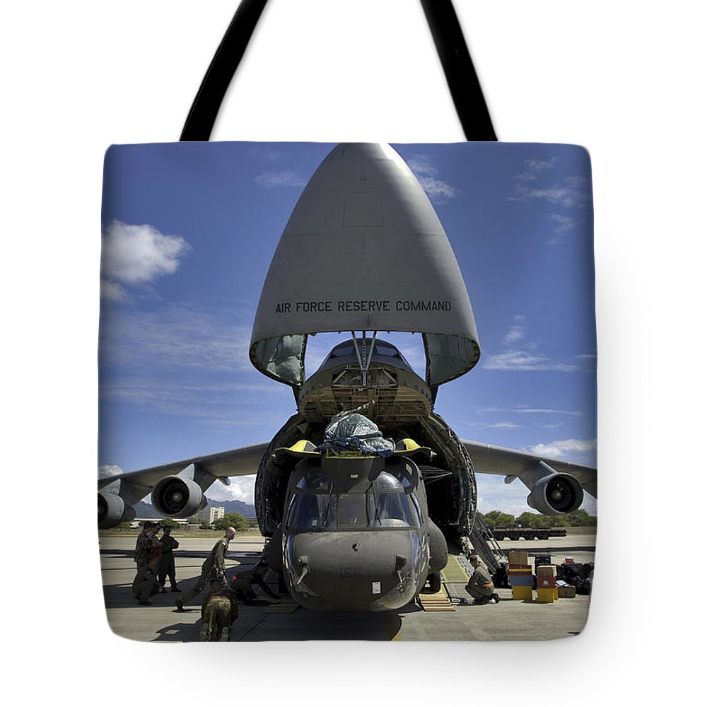 Military Tote Bag featuring the photograph Airmen And Soldiers Load A Ch-47 by Stocktrek Images
