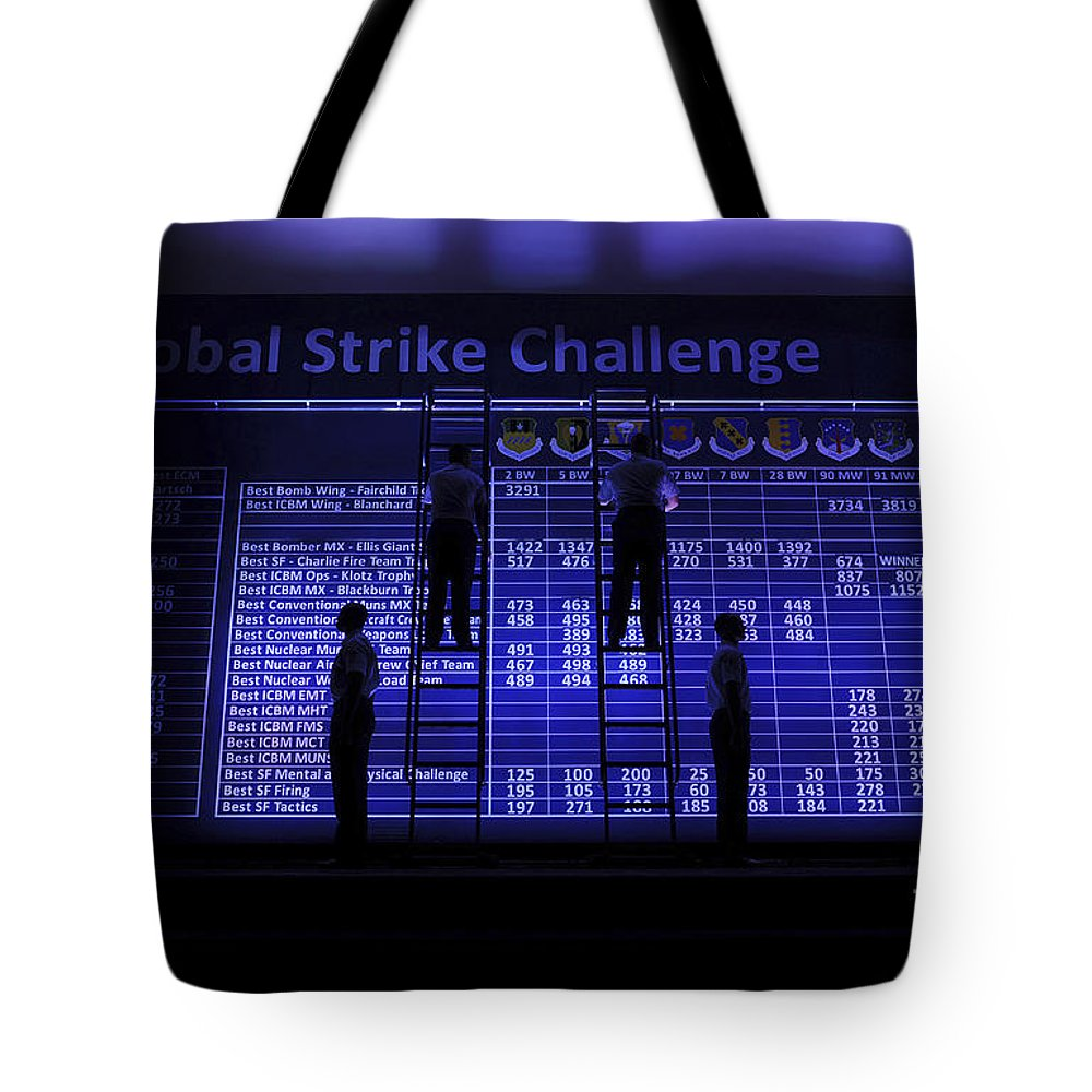 Indoors Tote Bag featuring the photograph Airmen Post The Scores During Global by Stocktrek Images